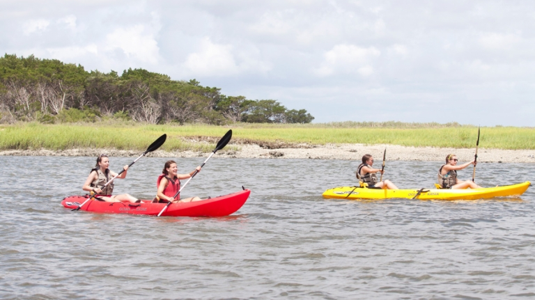 Rising Star students kayaking in the river