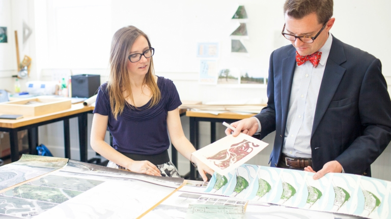 Urban design student showing work to professor