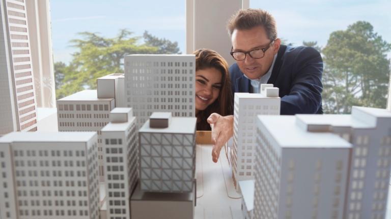 Urban design student and professor examine a model