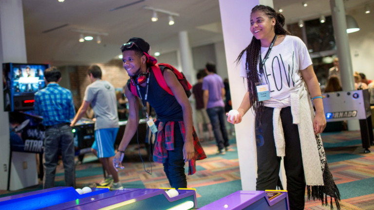Student play in arcade