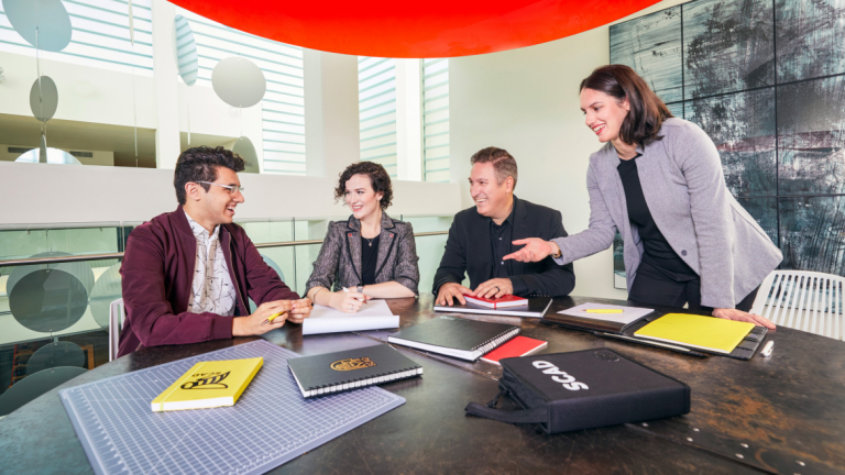 Students and faculty work on a project for Lenova through SCADpro