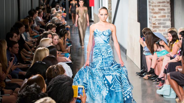 Model walking runway at SCAD Fashion Show