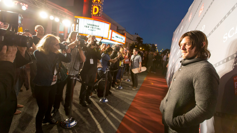 Actor Norman Reedus stands on the red carpet at the Savannah Film Festival