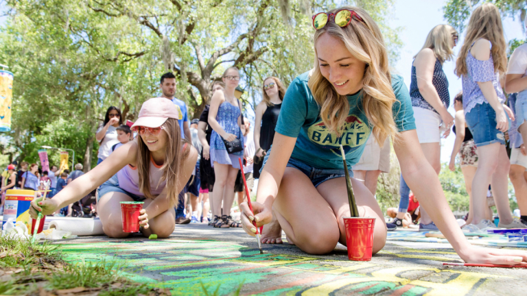 SCAD students painting with chalk at Sidewalk Arts Festival