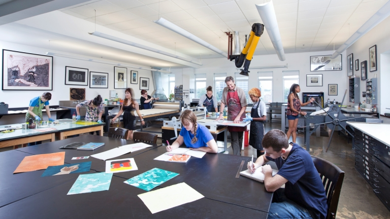 Printmaking professor and students working in the studio