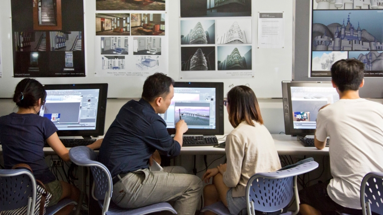 Animation professor instructing student in computer lab