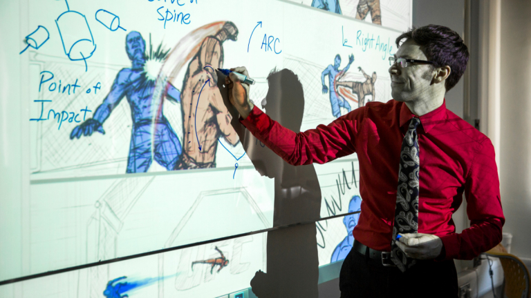 SCAD professor demonstrates drawing techniques on white board