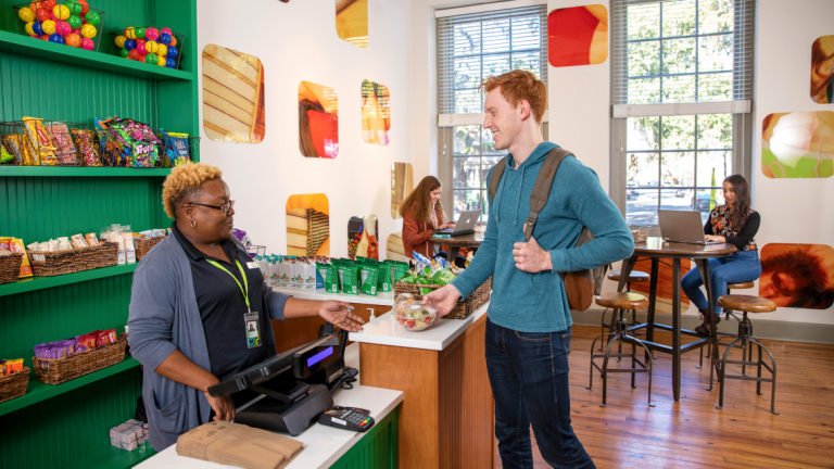 SCAD student purchases food to go from Arnold Micro Market