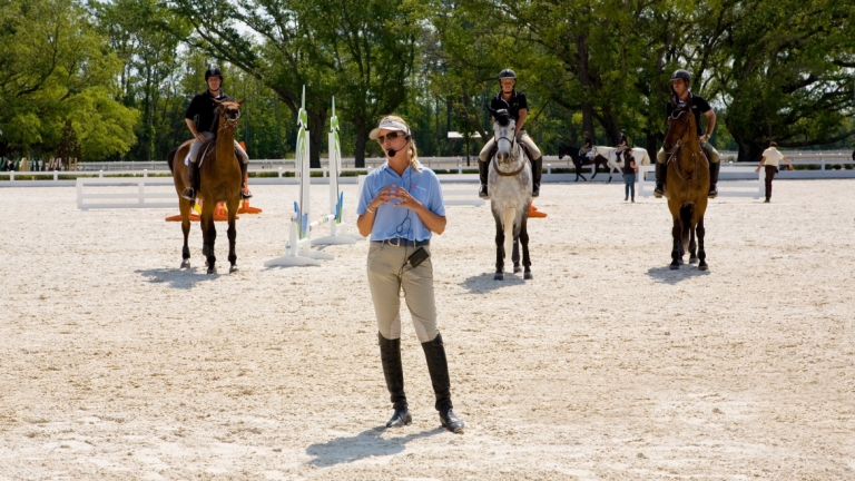 Equestrian studies coach Ashley Kelly instructing students