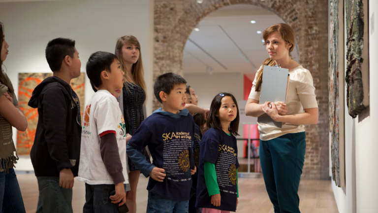 SCAD Museum of Art staff member giving tour to school children