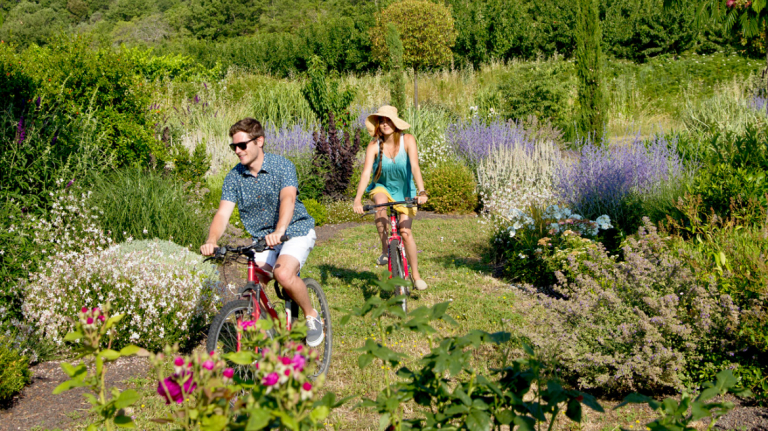 Students ride bikes at SCAD's serene Lacoste location