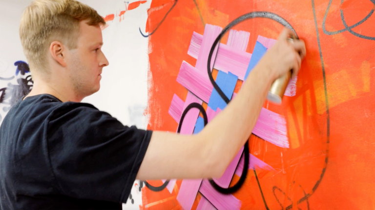 Play video of painting alumnus Daniel Byrd creating SCAD catalog cover