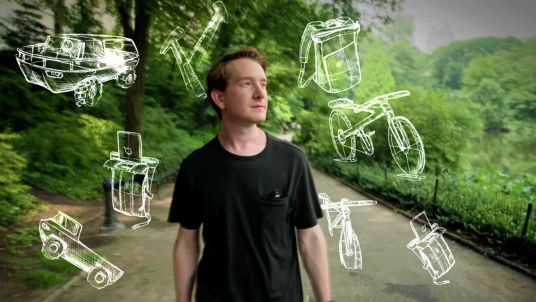 SCAD alumnus Nick Baker with industrial design sketches around head
