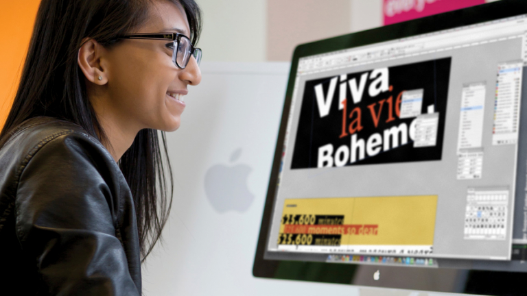 Advertising student using computer to create work