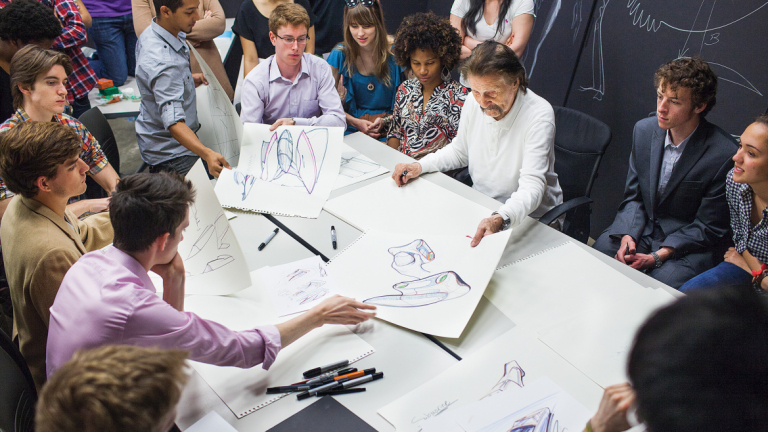 SCAD Style guest Luigi Colani reviewing designs in workshop with students