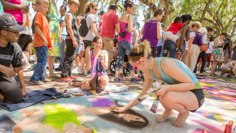 SCAD students creating chalk designs at Sidewalk Arts Festival in Forsyth Park