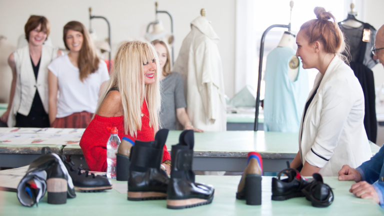 Fashion designer Betsey Johnson encouraging students