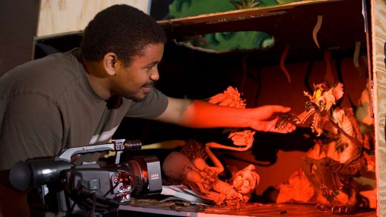 Animation student Brandon Milteer shooting stop motion puppets