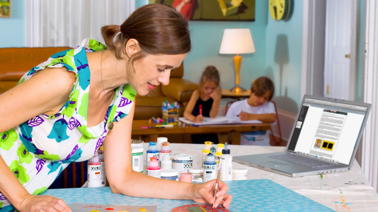 eLearning student painting at home with family