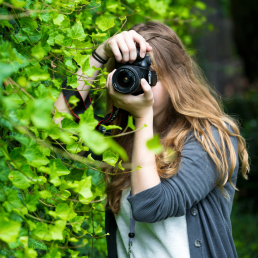 Pre-college student photographing outside