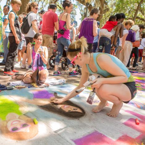 87331SCAD students creating chalk designs at Sidewalk Arts Festival
